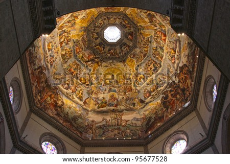 The Ceiling of the Duomo in Florence, Italy.  Featuring numerous Frescos. - stock photo