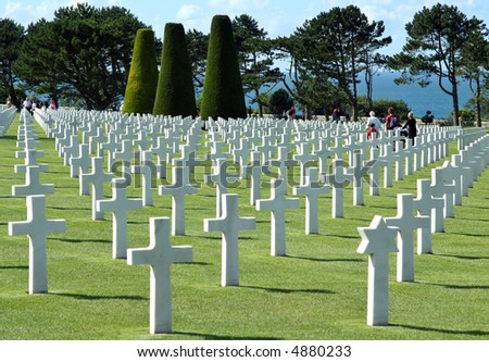 The cemetery is located on a cliff overlooking Omaha Beach (one of the landing beaches of  the Normandy Invasion) and the English Channel. This pool is a link between visitors and the  channel. - stock photo