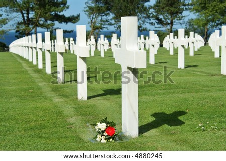 The cemetery is located on a cliff overlooking Omaha Beach (one of the landing beaches of the Normandy Invasion) and the English Channel. - stock photo