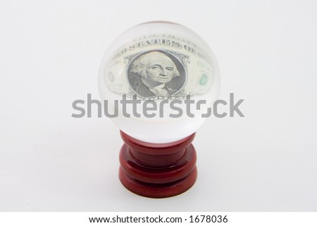 The center of a one dollar bill appears in a crystal ball. - stock photo