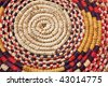the center of the bottom of a colorful worn african basket - stock photo