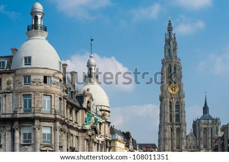 The central Cathedral of Our Lady and its surround buildings in downtown Antwerp, Belgium - stock photo