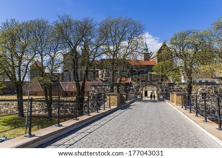 The central gate Akershus Festning, the oldest building of Oslo, with a preserved 1308 - stock photo