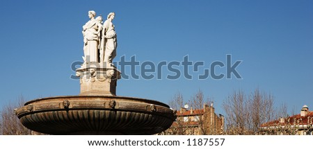 The central roundabout fountains in Aix-en-Provence, France.  Copy space. - stock photo