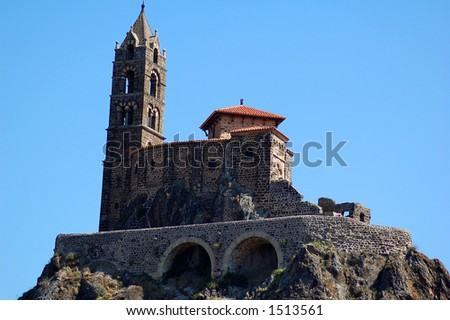 The 12-century cathedral Notre-Dame in the city of Le-Puy-en-Velay, in central France. This is one of the starting points for the pilgrimage to Spain's Santiago de Compostela. - stock photo