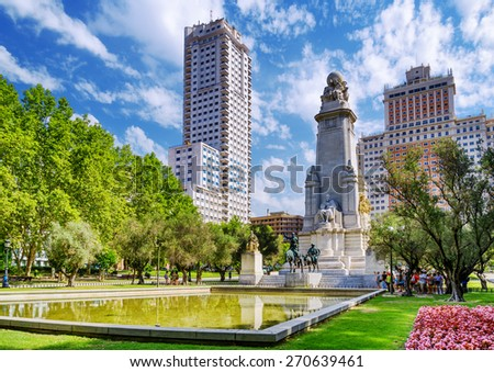 The Cervantes monument, the Tower of Madrid (Torre de Madrid) and the Spain Building (Edificio Espana) on the Square of Spain (Plaza de Espana). Madrid is popular tourist destination of Europe. - stock photo