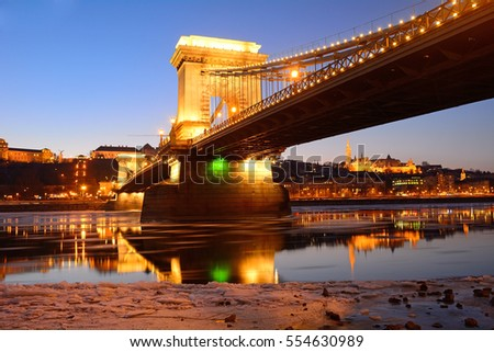 The Chain Bridge at sunset over the icy Danube River, Budapest, Hungary