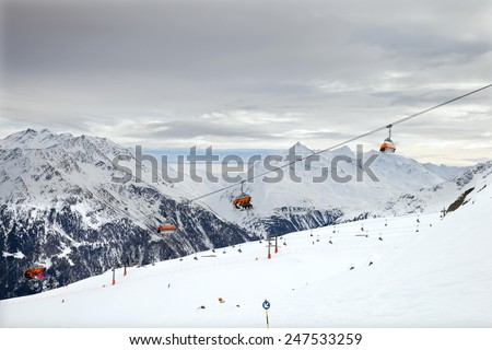 The chair cable car on european mountain resort in winter time - stock photo