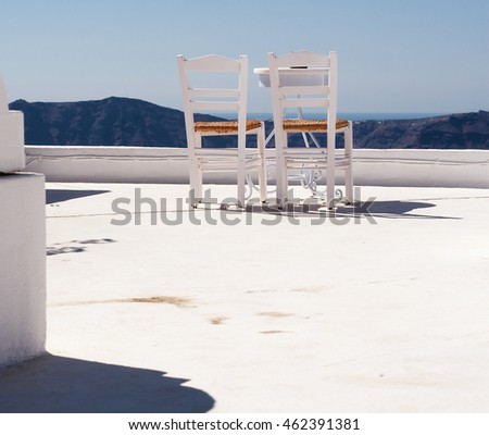 The chairs on the top of house
