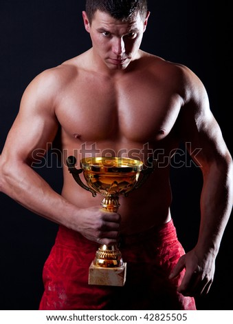 The Champion holding winning trophy