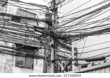 The chaos of cables and wires in city - stock photo