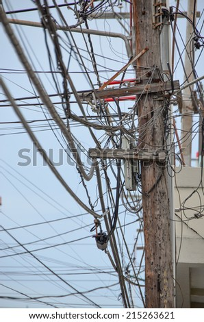 The chaos of cables and wires in Dominicana. - stock photo