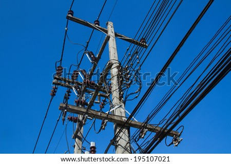 The chaos of cables and wires with blue sky - stock photo
