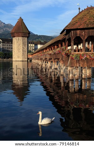 The Chapel Bridge and Lake Lucerne, in the city of Lucerne, Switzerland.  Photo taken early in the morning as the sun starts to rise.