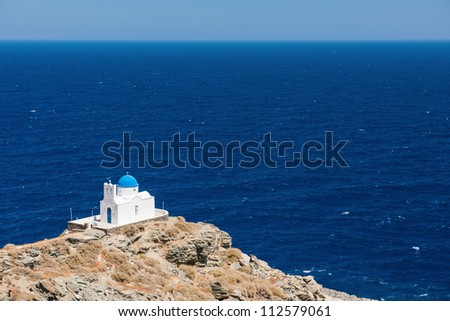 The chapel of 7 Martyrs, on the island of Sifnos, Greece, overlooking the Aegean Sea - stock photo