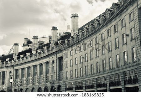 The characteristic curve of buildings on Regent Street in central London, UK. Retro toned. - stock photo