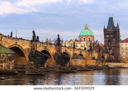 The Charles Bridge (Czech: Karluv Most) is a famous historic bridge that crosses the Vltava river in Prague, Czech Republic