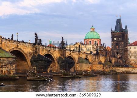 The Charles Bridge (Czech: Karluv Most) is a famous historic bridge that crosses the Vltava river in Prague, Czech Republic - stock photo