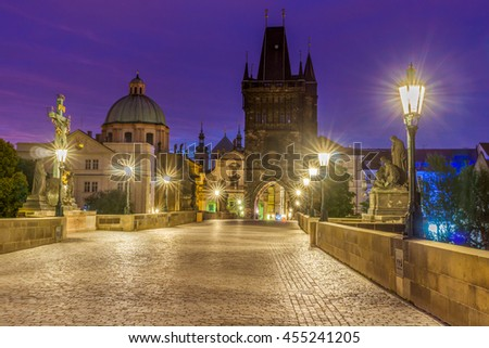 The Charles bridge is located in Prague, Czech Republic. Finished in the XV century, it is a medieval gothic bridge crossing the Vltava river. Its pillars are decorated with baroque statues of saints.