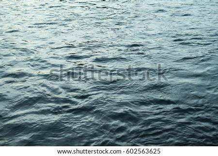 The charm of a water surface with slight ripples in the blue sea.