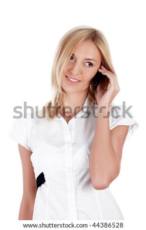 The charming blonde businesswoman in a white shirt calls on a cellular telephone