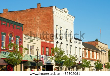 The charming old-fashioned Main Street of Chagrin Falls Ohio in early evening light - stock photo
