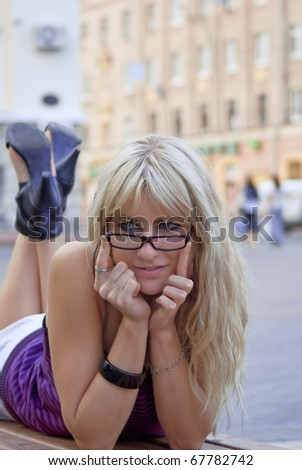 The charming young girl has carefree a rest in city centre - stock photo