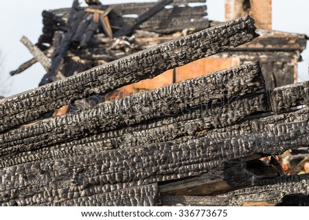 The charred ruins and remains of a burned down house - stock photo