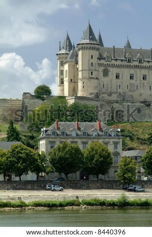 The chateau at saumur on the banks of the river loire.