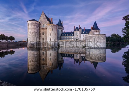 The chateau of Sully-sur-Loire at night, France. This castle is located in the Loire Valley, dates from the 14th century and is a prime example of medieval fortress. - stock photo
