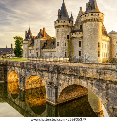 The chateau of Sully-sur-Loire at suset, France. This castle is located in the Loire Valley, dates from the 14th century and is a prime example of medieval fortress. - stock photo
