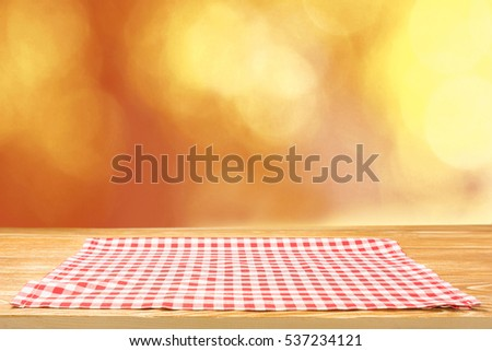 The Checkered Tablecloth On Wooden Table.