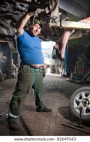 The cheerful car mechanician - stock photo