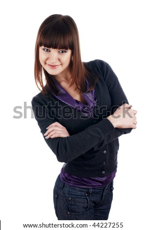 The cheerful charming brunette female in dark blue sweater isolated on white