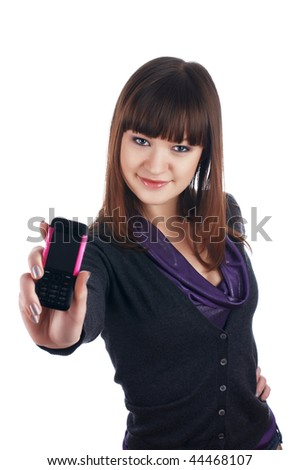 The cheerful charming brunette femalewith phone  isolated on white - stock photo