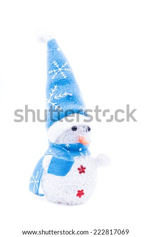 the cheerful Christmas snowman with blue hat, isolated on white background - stock photo