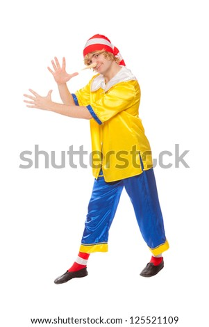 The cheerful clown in a pinocchio suit, isolated on a white background - stock photo