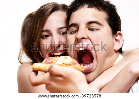 The cheerful couple eating a pizza - stock photo