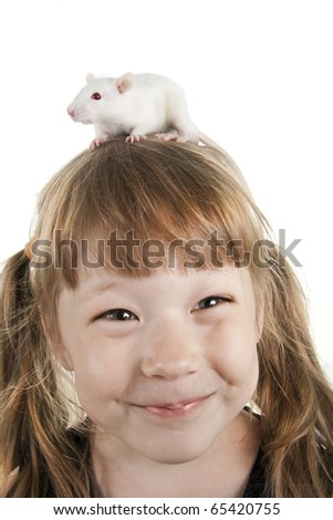 The cheerful girl with a rat on her head - stock photo