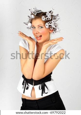 The cheerful woman in hair curlers - stock photo