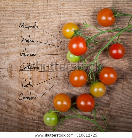 The chemical composition of tomato on the wood background - stock photo