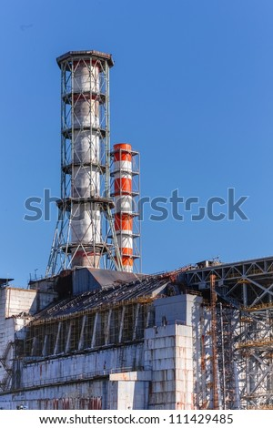 The Chernobyl Nuclear power plant against blue sky - stock photo