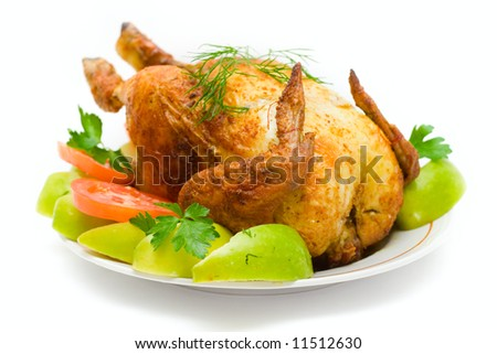 The chicken fried on a spit on a white background - stock photo