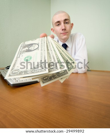 The chief stretching to us a pack of dollars - stock photo