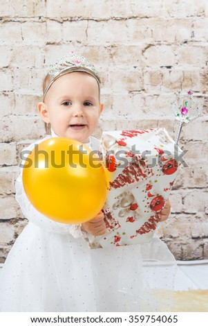 The child, a little girl princess with gifts - stock photo