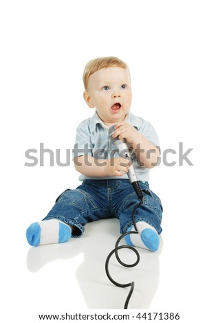 The child and a microphone - stock photo