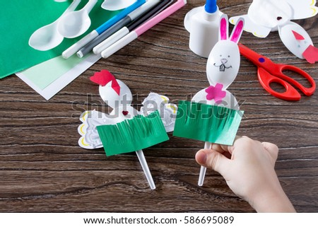 Child sticks gift items childrens easter stock photo 586694945 the child creates an easter gift toy easter bunny paper glue and plastic spoons negle Images