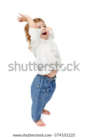 The child dances on a white background, lifted his leg, walks, indulge in, runs, plays, hands up - stock photo