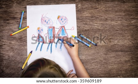 The child drawing a family - stock photo