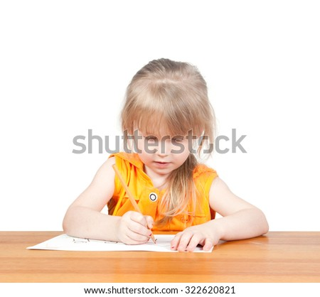 The child draws at the table. WHITE BACKGROUND - stock photo